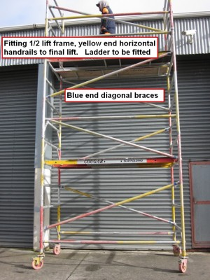 Step 10 - Fitting 1/2 lift frames & handrails to final lift. Ladder to be fitted. Finished 4m high working platform Mobile Tower